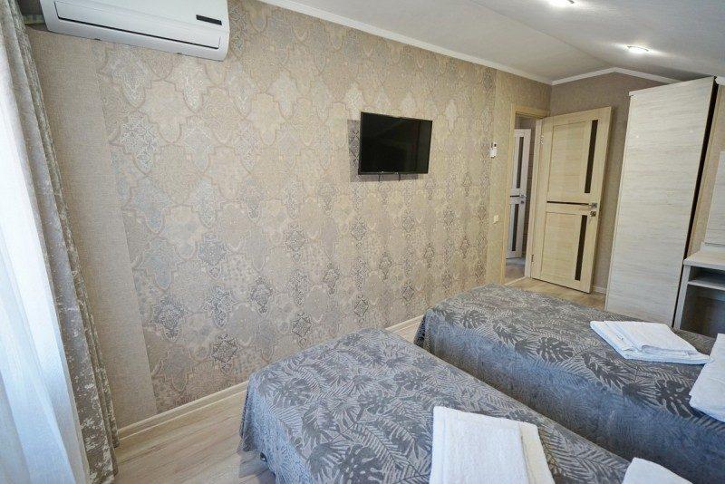 Коттедж 4 - Спальня с двумя односпальными кроватями на втором этаже