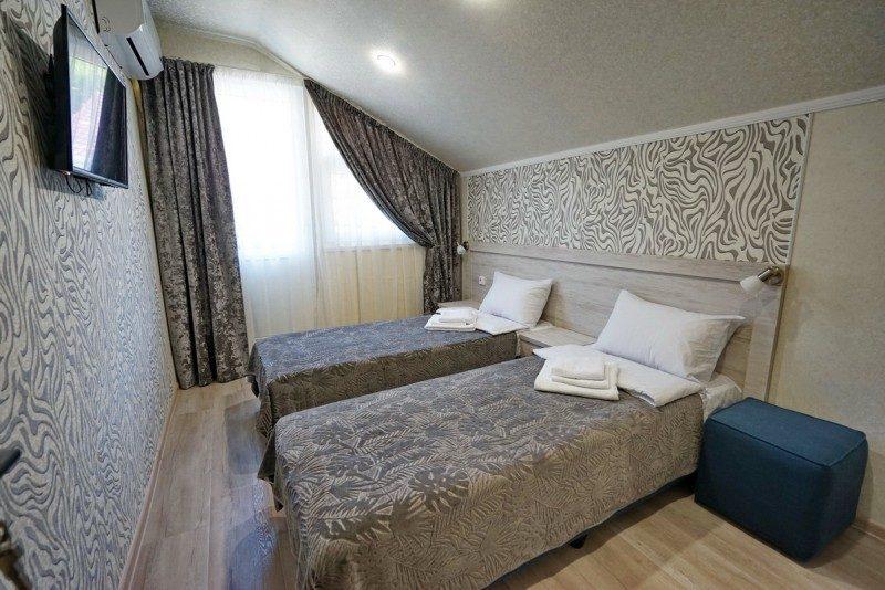 Коттедж 1 - Спальня на втором этаже с двумя односпальными кроватями